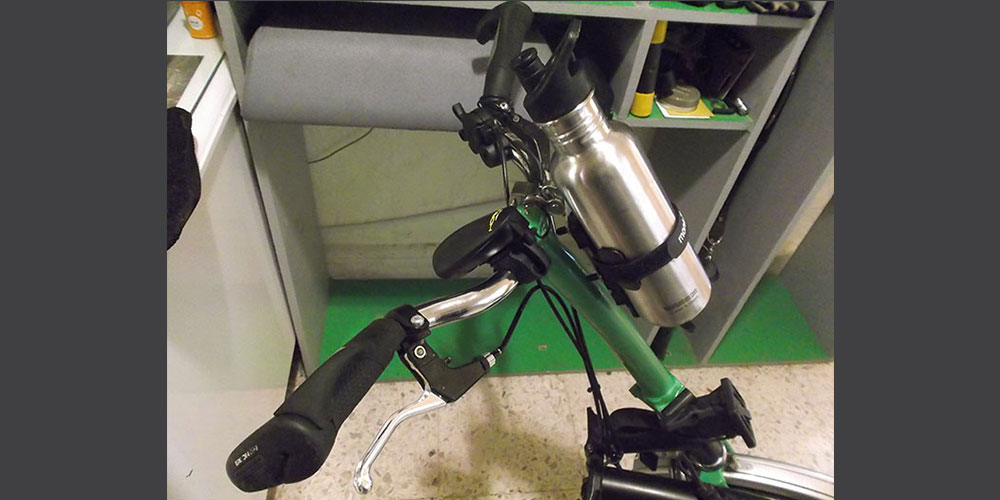 Oscar's Brompton bicycle and monkii bottle cage